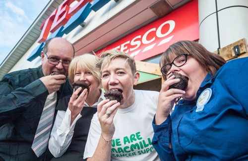 Biting into Tesco muffins are Graham Hobbins (Brakes Trust), Cathy Wahlberg (Operations and Finance Member from Alsters Kelley LLP), Catherine Thomson (representing Macmillan) and Sarah Wrist (Warwick Tesco).